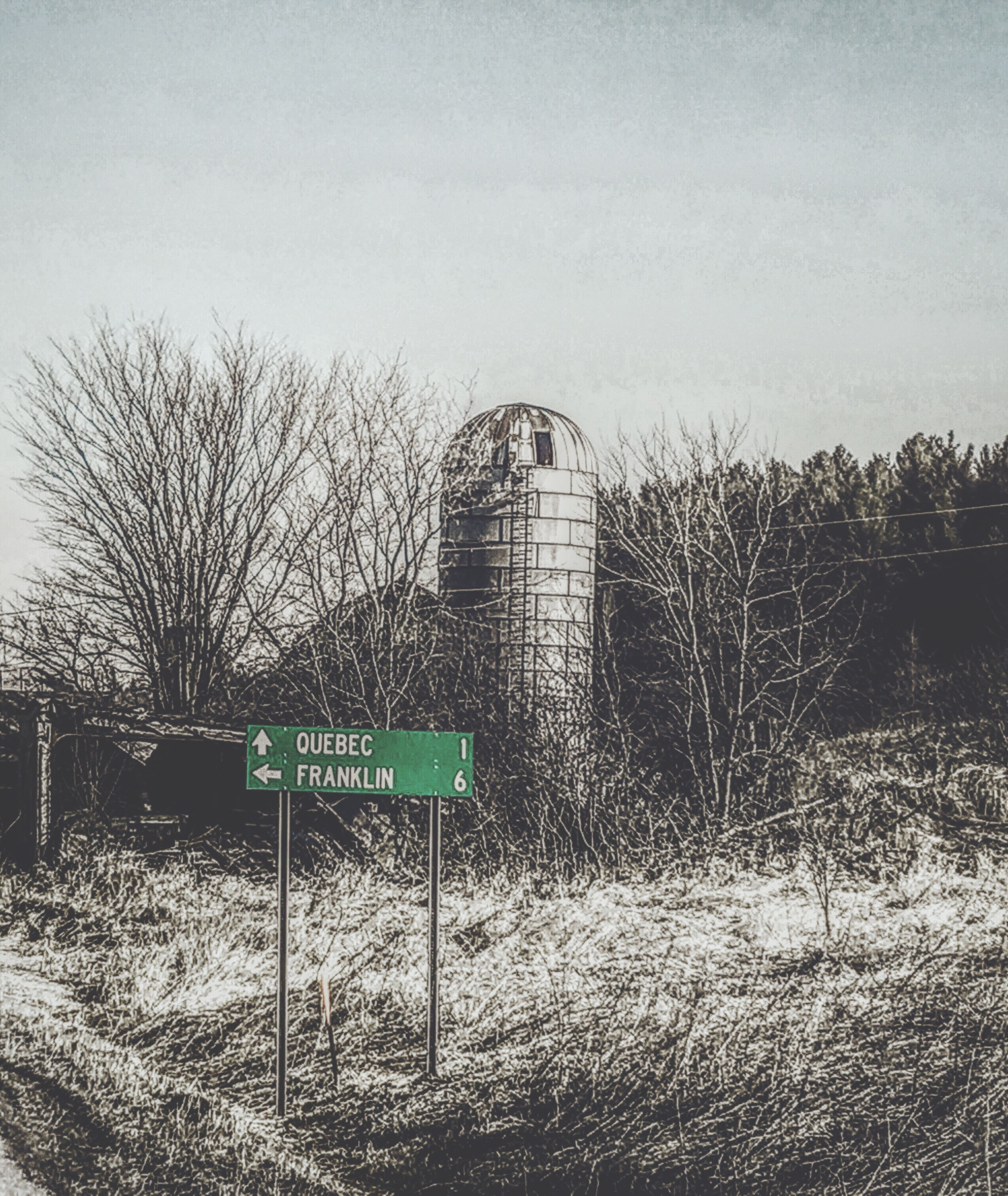 grass, clear sky, field, tree, fence, text, sky, protection, plant, safety, day, built structure, absence, outdoors, western script, no people, empty, communication, information sign, nature