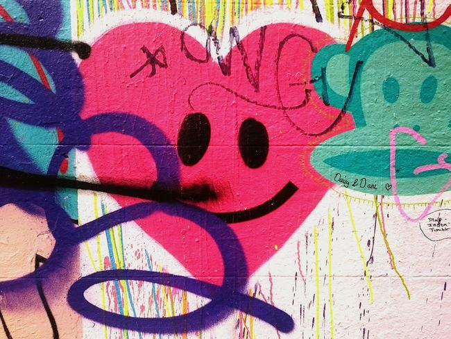 Graffiti Creativity Wall - Building Feature Backgrounds Multi Colored Full Frame Street Art Outdoors Art Streetphotography Urban Landscape Street Photography Spraypaint Neon Color Graffiti Textures And Surfaces Aerosol Graphic Amusement  Smile Heart