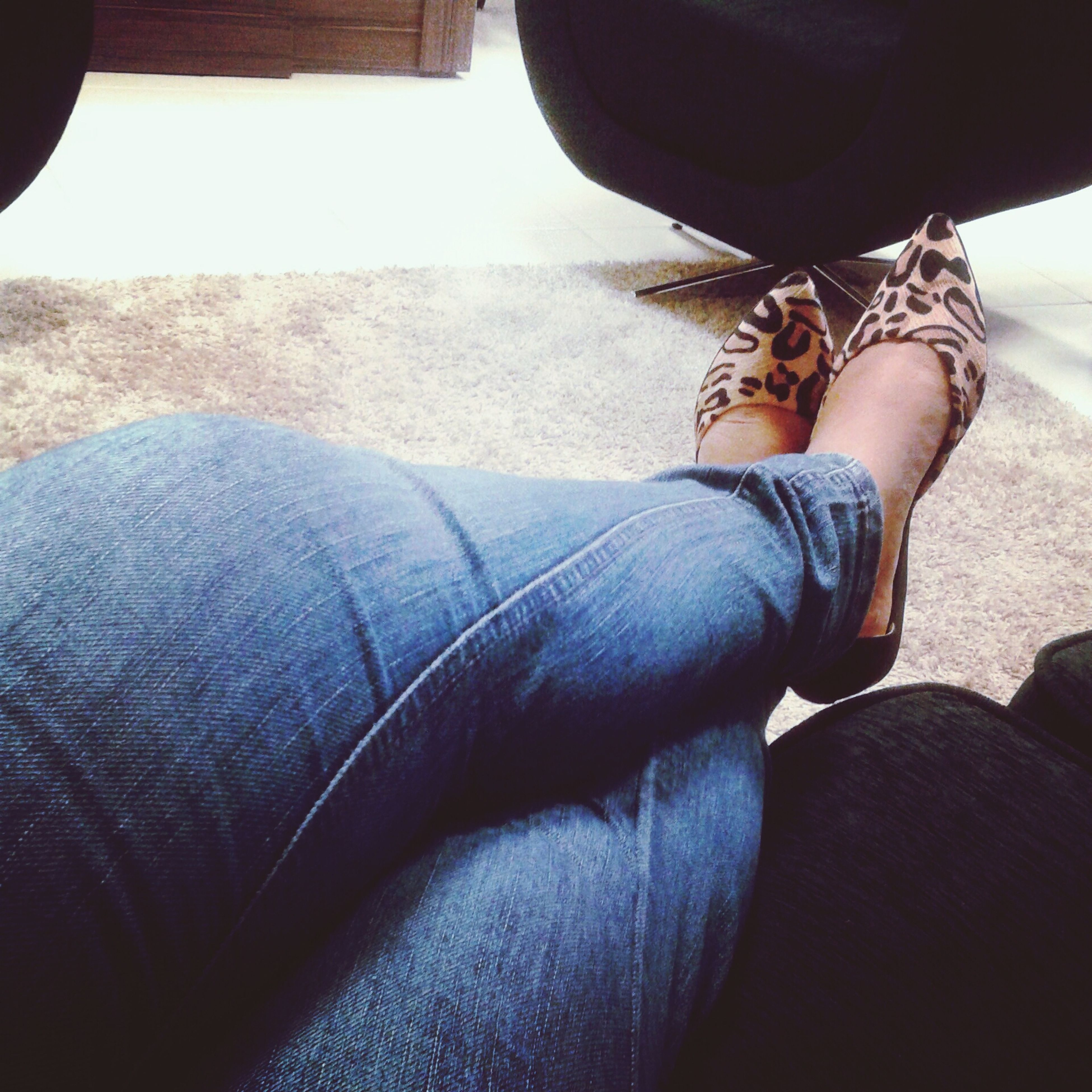 low section, person, lifestyles, jeans, leisure activity, personal perspective, human foot, shoe, relaxation, sitting, part of, casual clothing, men, legs crossed at ankle, close-up, day