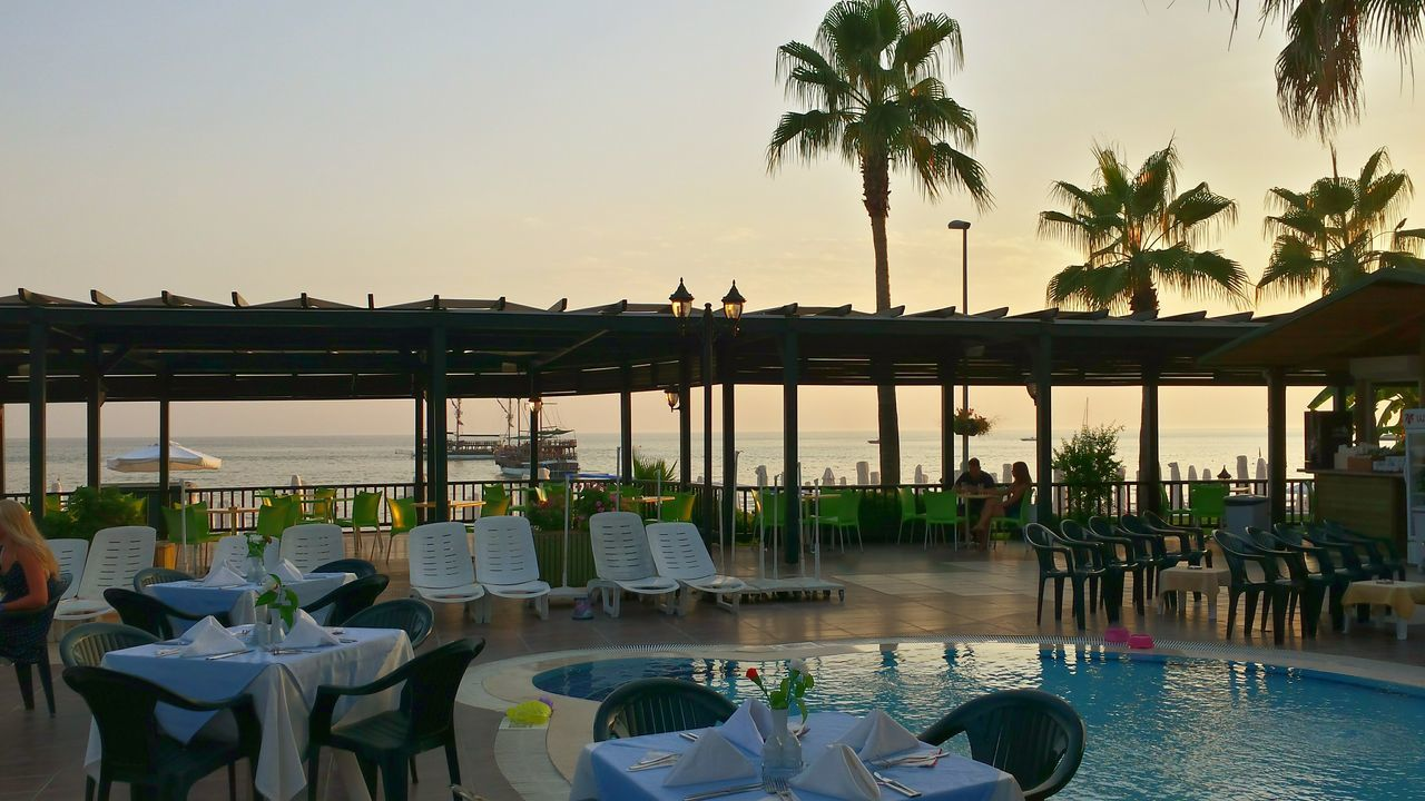 Poolside Dining with View Onto Pool And Sea Great Atmosphere After Sunset On A Holiday Side Turkey Hotel Sandy Beach Poolside Outside Dining