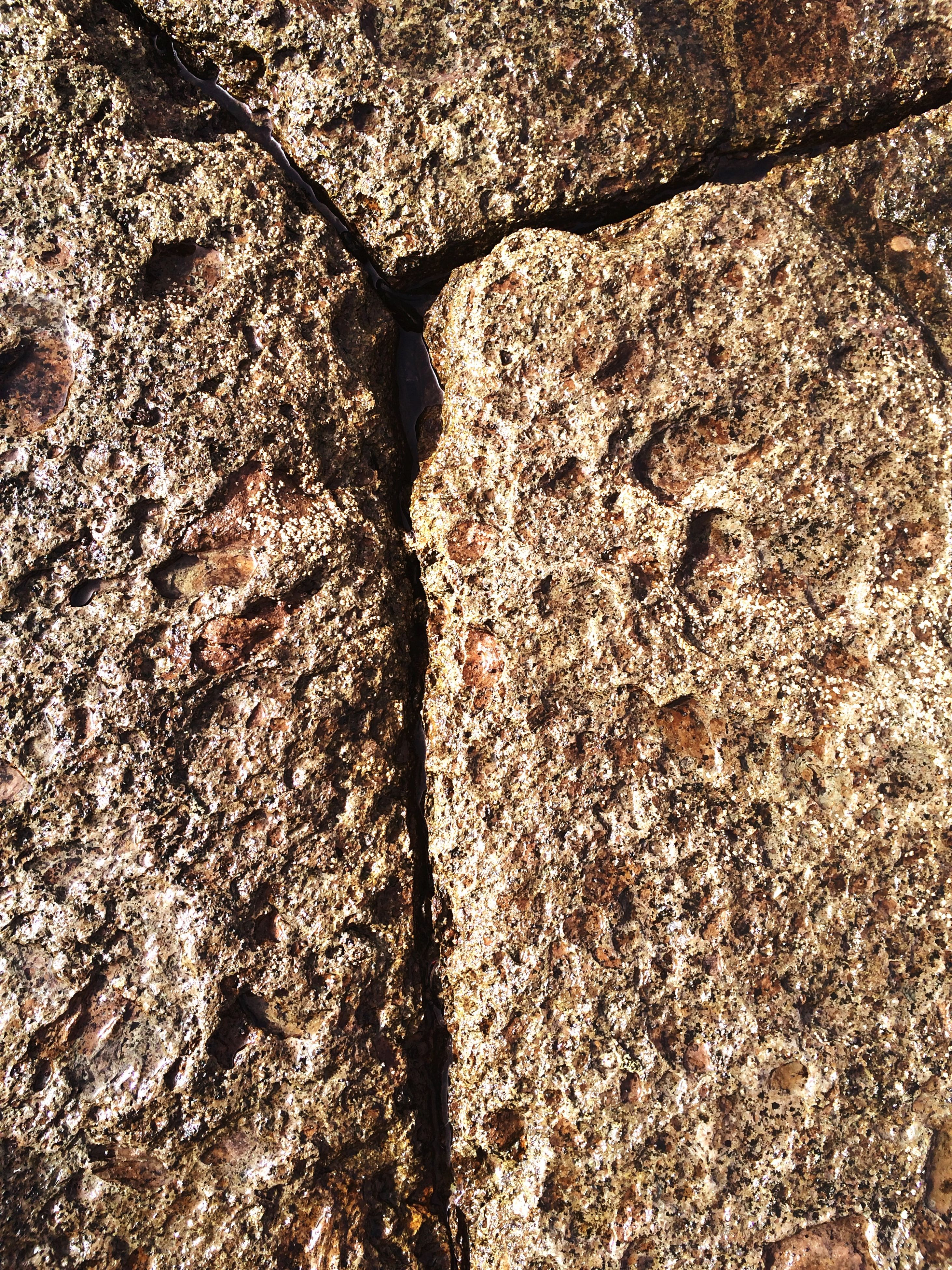 textured, full frame, backgrounds, rough, pattern, high angle view, close-up, day, no people, nature, cracked, outdoors, stone - object, rock - object, weathered, sunlight, detail, natural pattern, wall - building feature, old