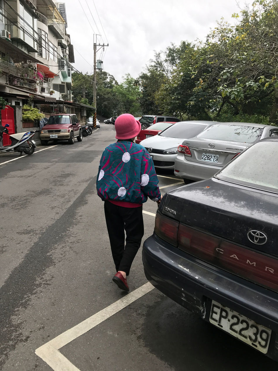 Built Structure Car Casual Clothing City Break Day Headwear One Person Only Women Outdoors People Rear View Senior Woman Sky Standing