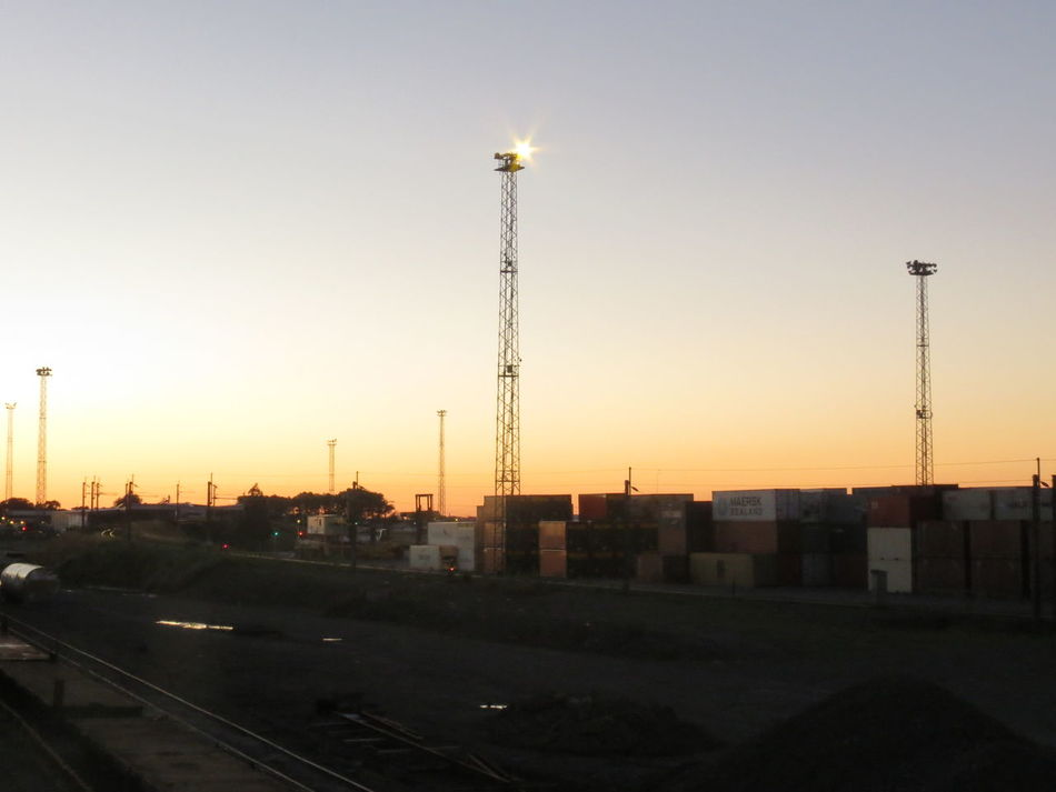 Sunset City No People Business Finance And Industry Outdoors Sky Day Protection Safety Security Train Tracks Station Fences Glow Architecture Oil Industry Silhouette Railway Scenics Boundary Built Structure Streetlight Railway Station Railroad Palmerston North Nz The City Light