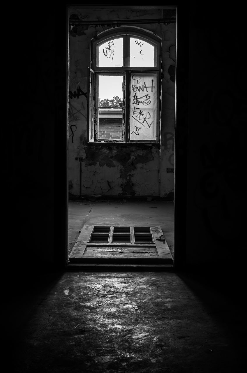 Window Seen Through Entrance Of Abandoned House