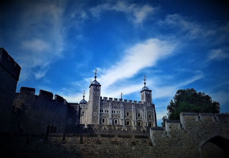 Here is a colour shot of the Tower of London. Architecture Blue Blue And White Sky Building Exterior Built Structure Castle Castles Cloud - Sky Day England, UK Historical History History Architecture London London_only LONDON❤ Low Angle View No People Outdoors Sky Tourist Attraction  Tourist Attractions Tower Of London Travel Destinations United Kingdom