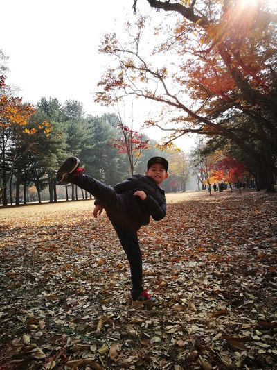 Taekwondo Full Length Tree Males  Only Men One Person One Man Only Park - Man Made Space People Childhood Outdoors Autumn Happiness Adults Only Men Day Adult Nature Young Adult