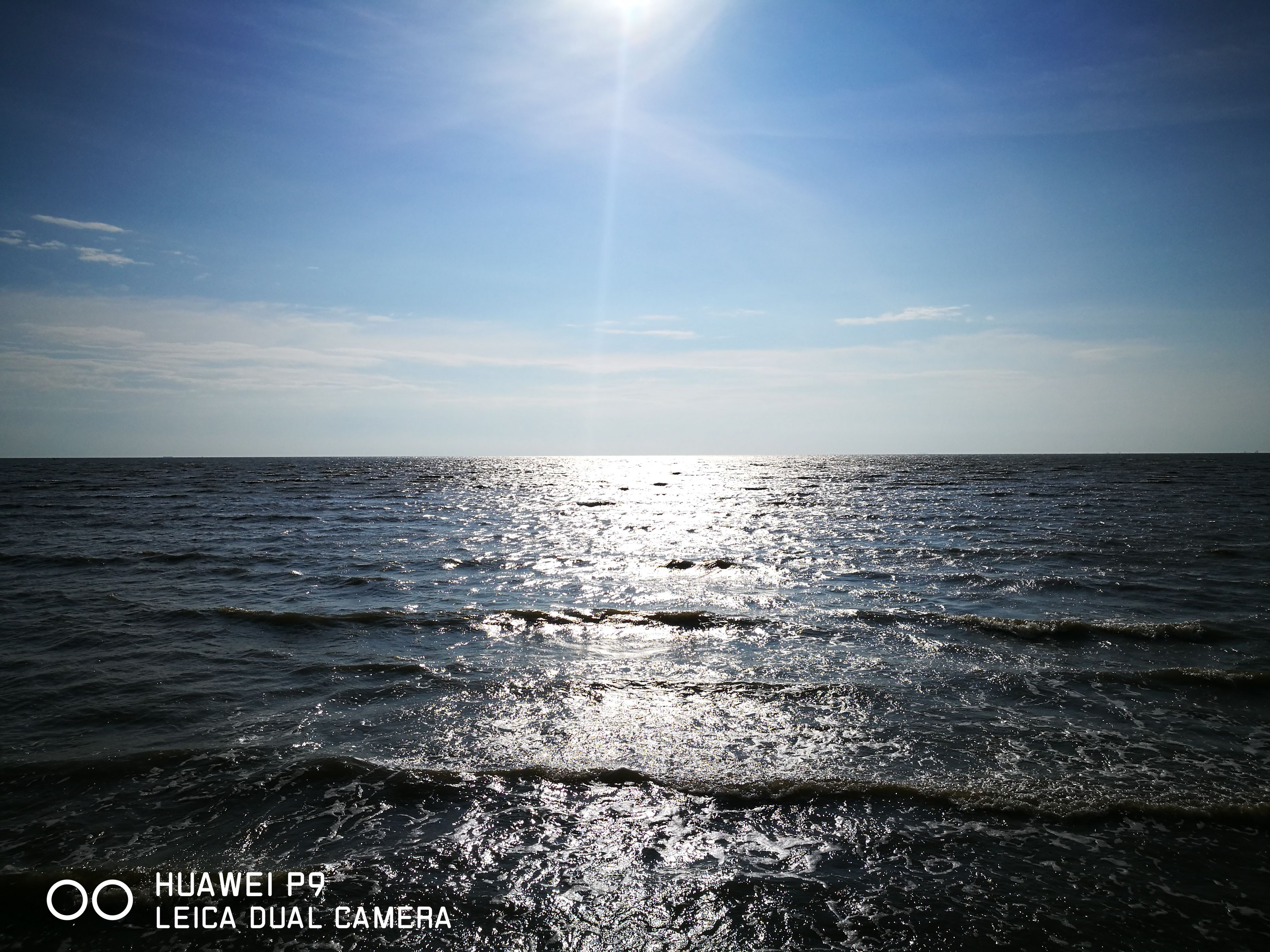 sea, sky, horizon over water, sunlight, nature, scenics, tranquility, beauty in nature, sun, no people, water, outdoors, day