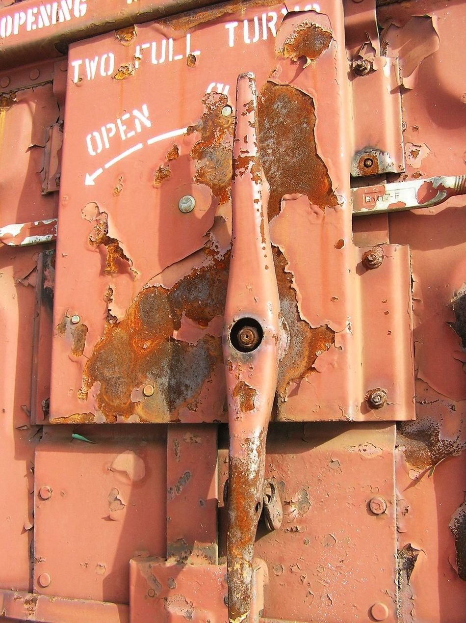 Battered Box Car Chipped Paint Close-up Corrosion Faded Paint Handle Latch No People Open Outdoors Paint Flaking Railroad Security Rolling Stock Rust Steel Stencil Lettering Turn