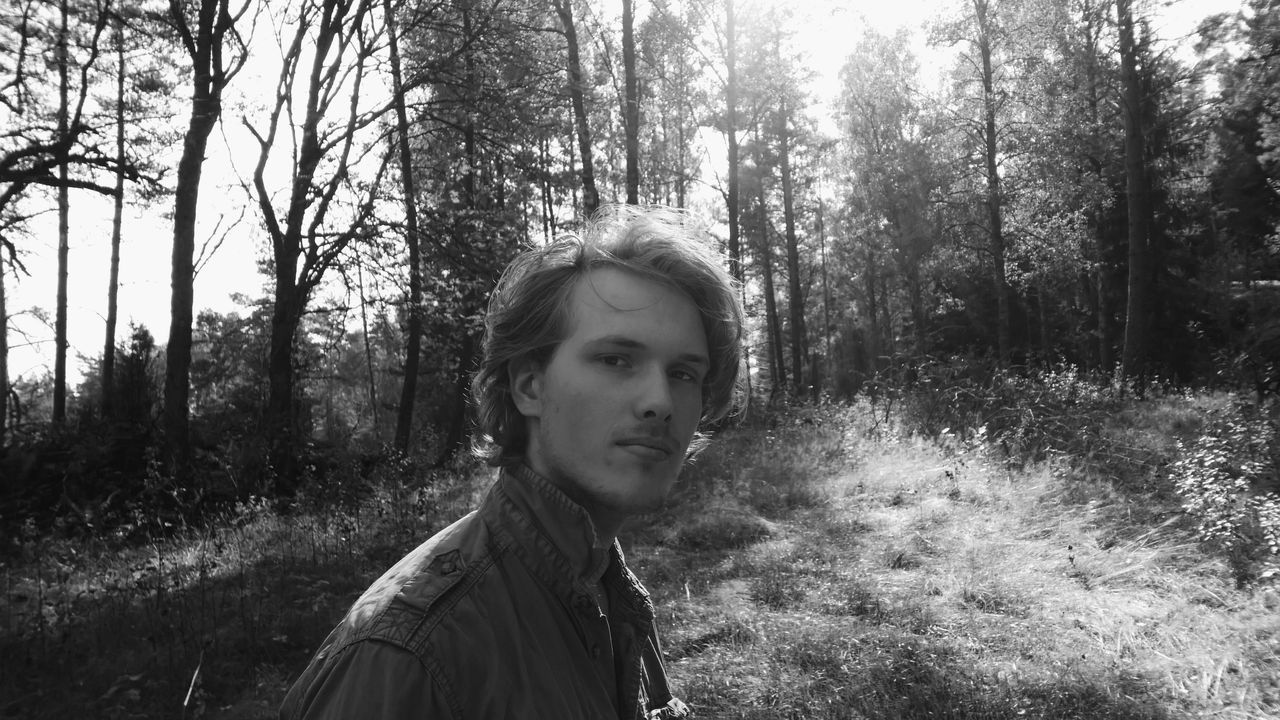 Blackandwhite Casual Clothing Childhood Faces In Places Faces Of EyeEm FacesOfEyeEm Forest Front View In The Forest Leisure Activity Lifestyles Looking At Camera Man Men Person Portrait Real People Reflection Standing Summer Sunlight Sunshine Women Nordic Light Young Men
