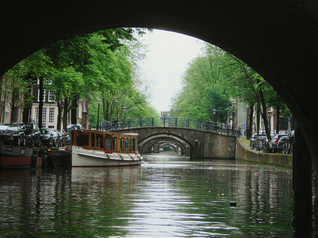 Your Amsterdam Green Water Reflections Amesterdao Green Tree Nature The KIOMI Collection Showcase April Taking Photos Netherlands Holland City Amsterdam City Life Boats River Stone Bridge Bridges Channels