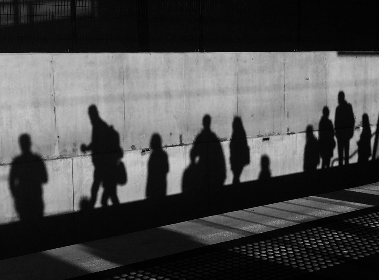 Silhouette of various people waiting for the train. The commuter story - The commuter saga. Architecture building exterior built structure City Commuter commuter train day large group of people leisure activity lifestyles men outdoors people real people shadow shadow of people Silhouette Sunlight waiting for the train women The Street Photographer - 2017 EyeEm Awards