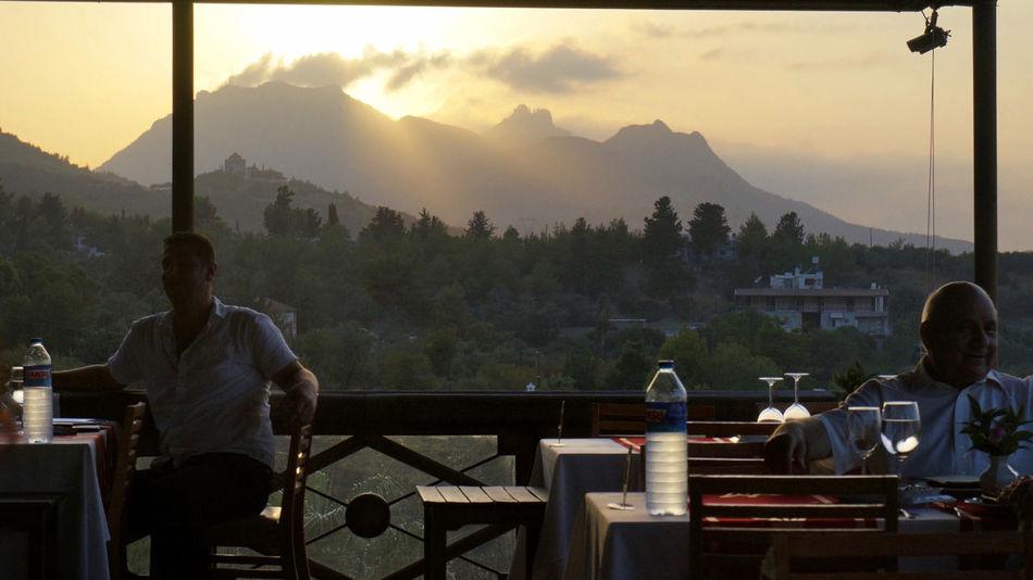 Lifestyles Men Mountain Mountain Range Nature People Real People Restaurant Scenics Sky Sunset Tree