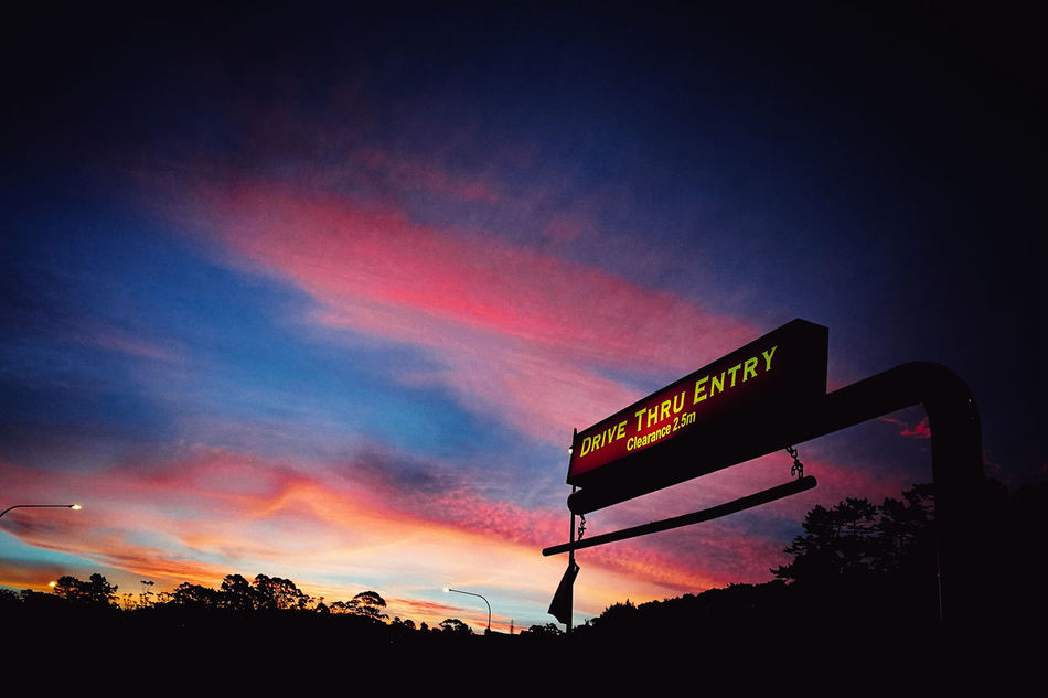 Communication Sunset Text Low Angle View Night Outdoors Arts Culture And Entertainment No People Road Sign Sky Beauty In Nature Neon Reflection Close-up Cloud - Sky Lifestyle Yellow Scenics Change Day Beauty
