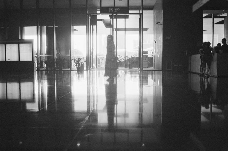 Real People Indoors  Reflection Airport Men Passenger Window Lifestyles Leisure Activity Door Standing Women Journey Airport Departure Area Waiting Full Length Travel Walking Luggage Transportation Building - Type Of Building Eyeem Market Blackandwhite EyeEm HongKong