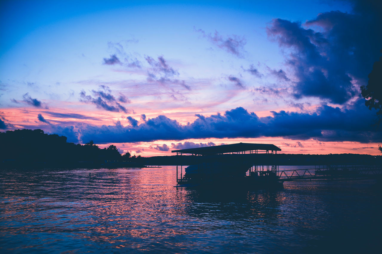 Beauty In Nature Boat Dock Cloud - Sky Documentary Outdoors Scenics Silhouette Sky Sunset Tranquility Water Waterfront