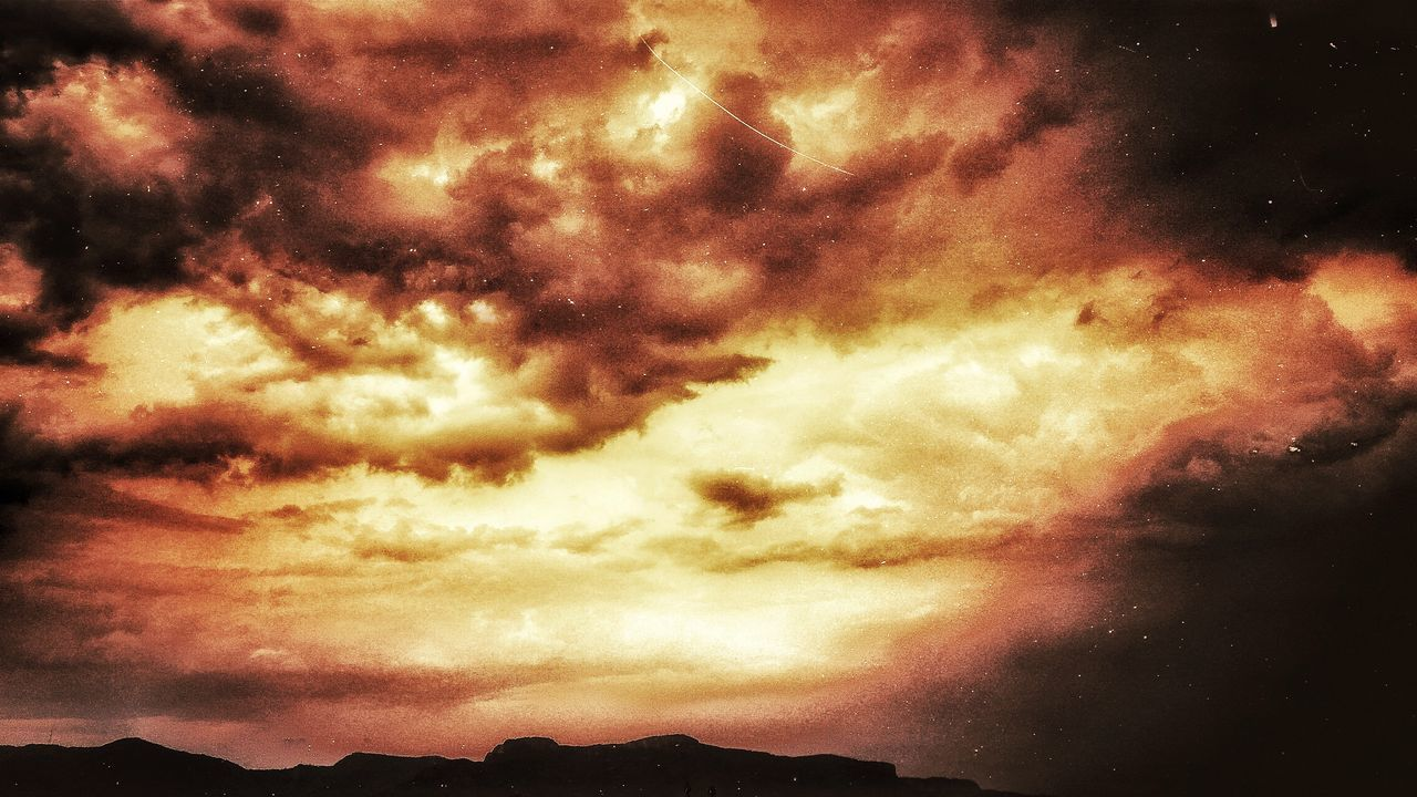 cloud - sky, sky, dramatic sky, beauty in nature, scenics, nature, sunset, tranquility, cloudscape, tranquil scene, no people, outdoors, sky only, low angle view, storm cloud, silhouette, mountain, day