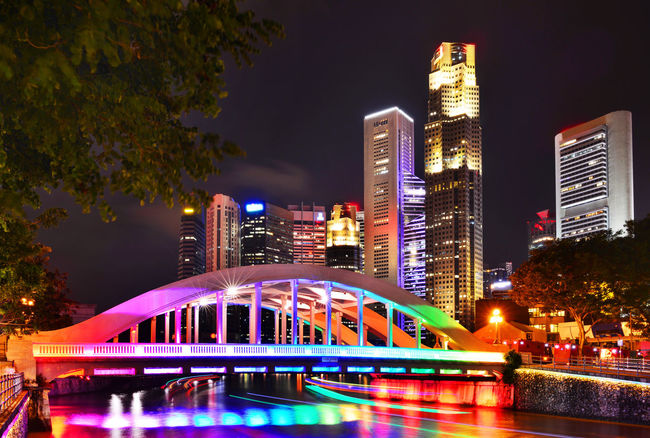 Marina Bay is a bay located in the Central Area of Singapore. Architecture Blue Built Structure Capital Cities  City City Life Cityscape Elgin Bridge Illuminated Light Trail Modern Multi Colored Night Night View No People Office Building Outdoors Singapore Sky Skyscraper Tall - High Tourism Travel Destinations Tree