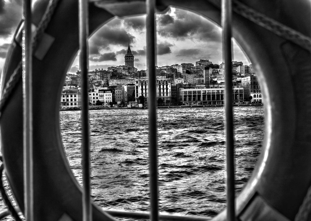 Cityscape Seen Through Life Belt On Boat