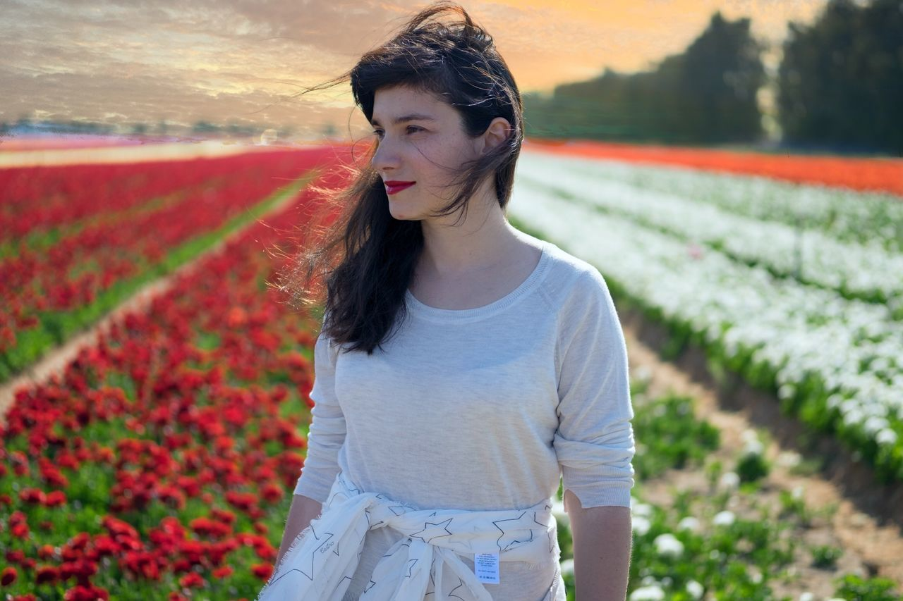 Live For The Story One Person Growth Young Women Young Adult Outdoors Real People Front View Flower Field Day Nature Lifestyles Standing Beauty In Nature Freshness Adult People