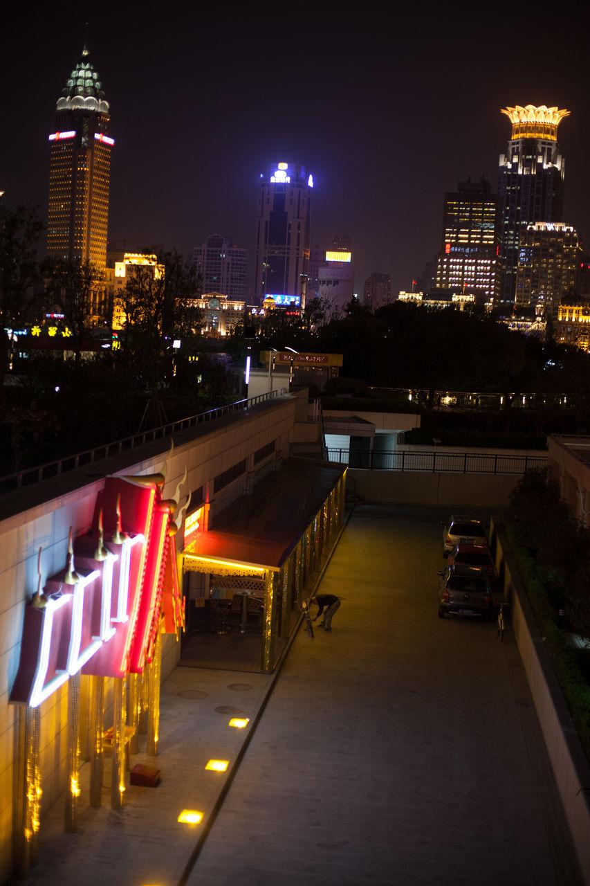 Illuminated Bund Center And Chrysler Building At Night