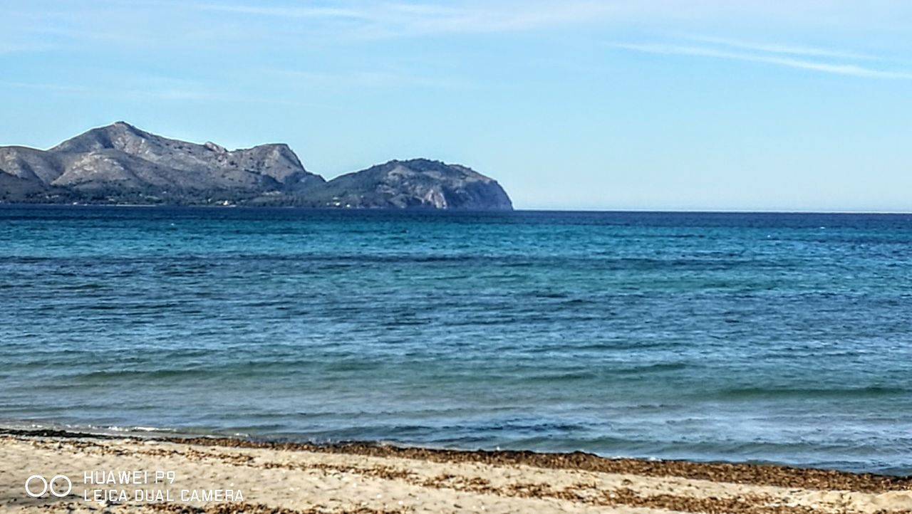 Mountains around the ocean...this is the north of Mallorca...many different structures...love it! Sea Beach Outdoors Cloud - Sky Scenics Mountain Landscape Water PalmaDiMaiorca Originalpicture GetbetterwithAlex Tranquility