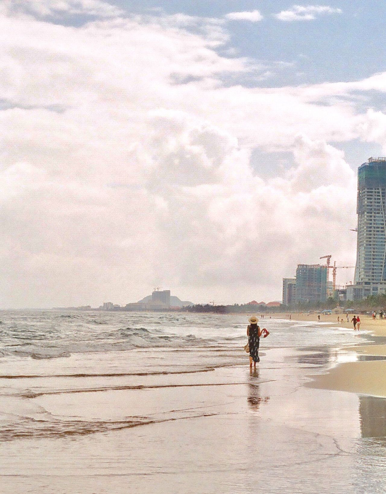Sea Sky Lifestyles Architecture Water Beach Full Length Walking Building Exterior Outdoors Cloud - Sky Built Structure Women Rear View Day Togetherness Vietnam Light And Shadow Danang Holiday Travel Relaxing Filmphotography Beauty In Nature Filmisnotdead