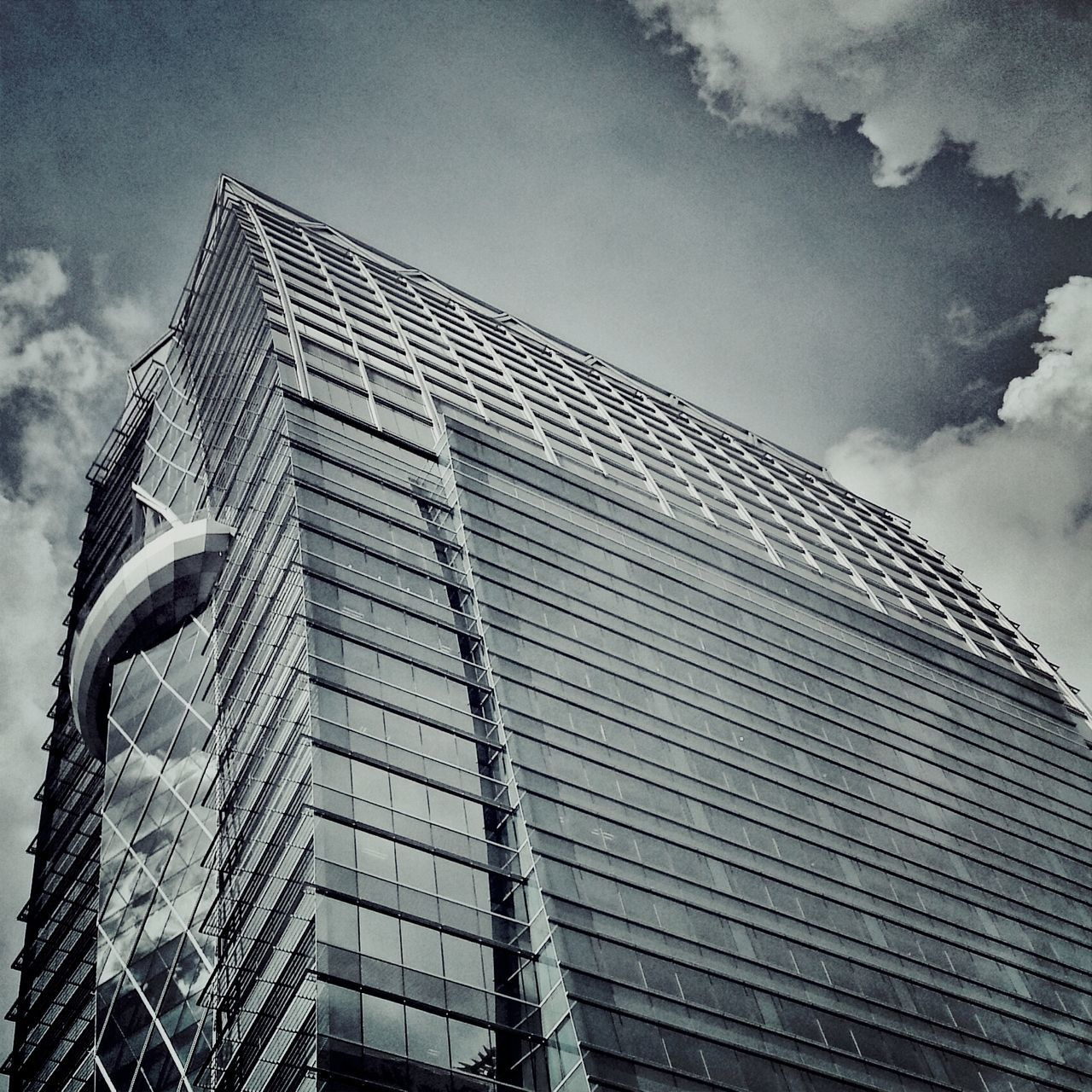 architecture, low angle view, built structure, building exterior, sky, outdoors, cloud - sky, modern, no people, day, skyscraper, city