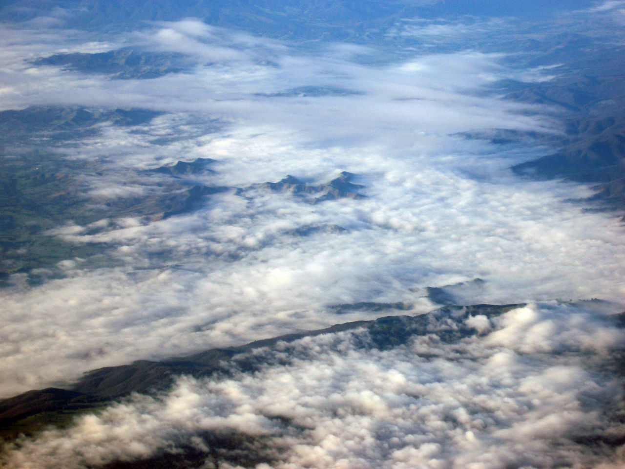 an aerial view of a range of mountains Aerial View Atmosphere Cloud Clouded Clouds Cloudscape Cloudy Earth From A Plane Window Landscape Looking Down Mountain Mountains Planet Range Sky Topography Topology