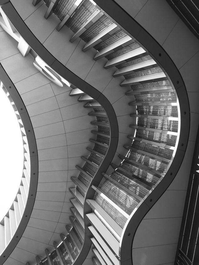 Indoors  Architecture Built Structure High Angle View Steps Repetition Railing Steps And Staircases Design Modern Blackandwhite Black And White Black & White Blackandwhite Photography Blach&white Staircase Directly Below Spiral Geometric Shape Coil The Way Forward Concentric No People Diminishing Perspective Monochrome Photography