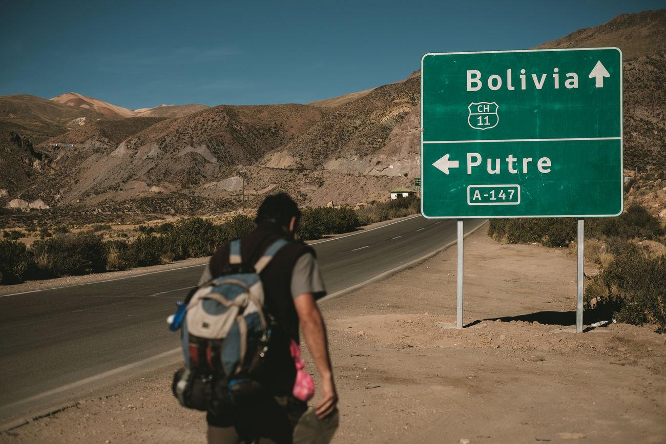 Adventure Amazing View Arid Climate Backpacking Border Chile Desert Landscape Highland Hiking Lifestyles Men Mountain Range National Park Outdoors Outstanding Beauty Parinacota Parque Nacional Lauca Y Putre Putre Road Sign Travel Trekking Vacations Wonder