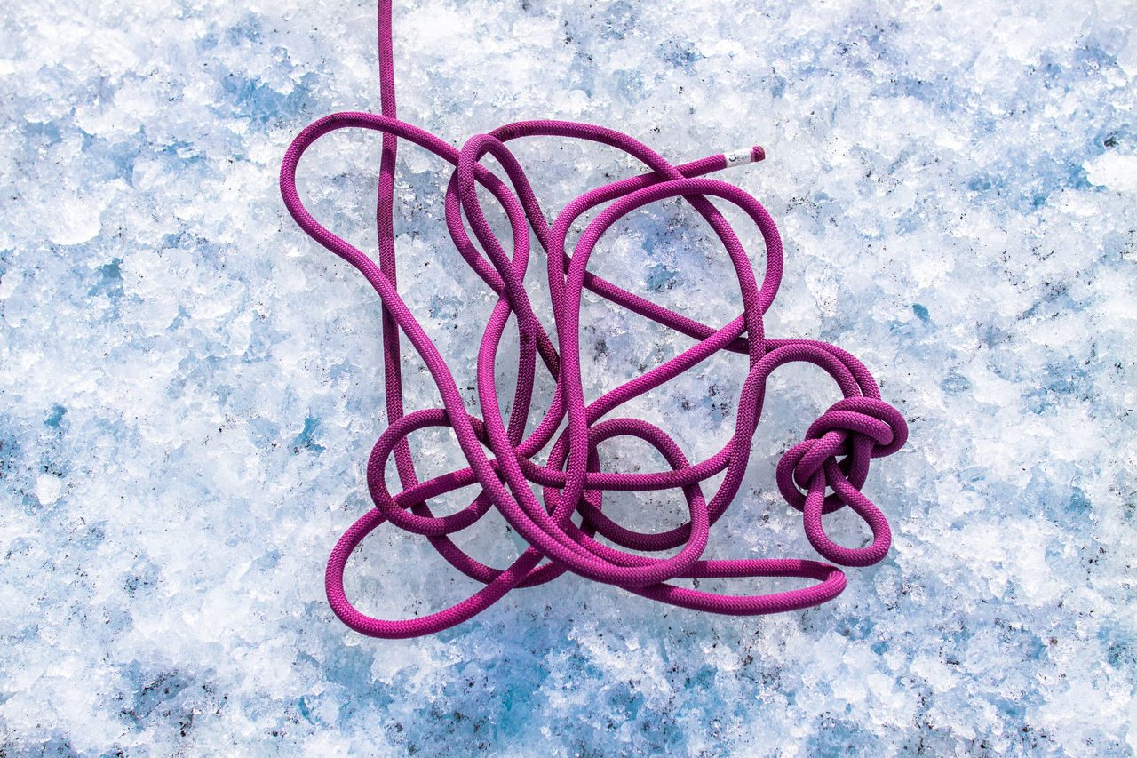 Climbing rope at glacier. Buarbreen Climbing Climbing Rope Cold Temperature Crashed Ice Day Directly Above Entangled Folgefonna Glacier Glacier Hike High Angle View Ice Ice Climbing Mountain Climbing No People Node Outdoors Pink Color Red Rope Rubber Band