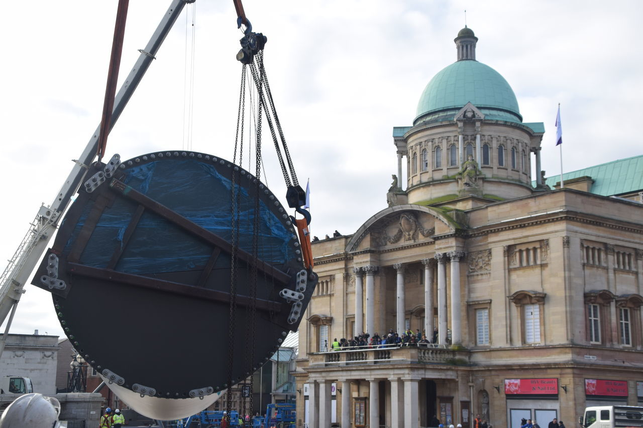 Siemens wind turbine blade is lifted into position in Hull's Queen Victoria Square (08/01/2017) during Hull 2017 City Of Culture Architecture Blade Building Exterior Built Structure City Day Dome Hull Hull 2017 Hull City Of Culture 2017 Hull2017 Industry No People Outdoors Siemens  Sky Wind Turbine