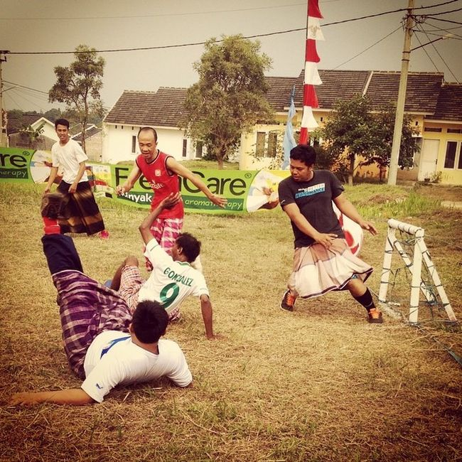 Tujubelasan Falling in Traditional Football Game Funny Snap Jakarta INDONESIA