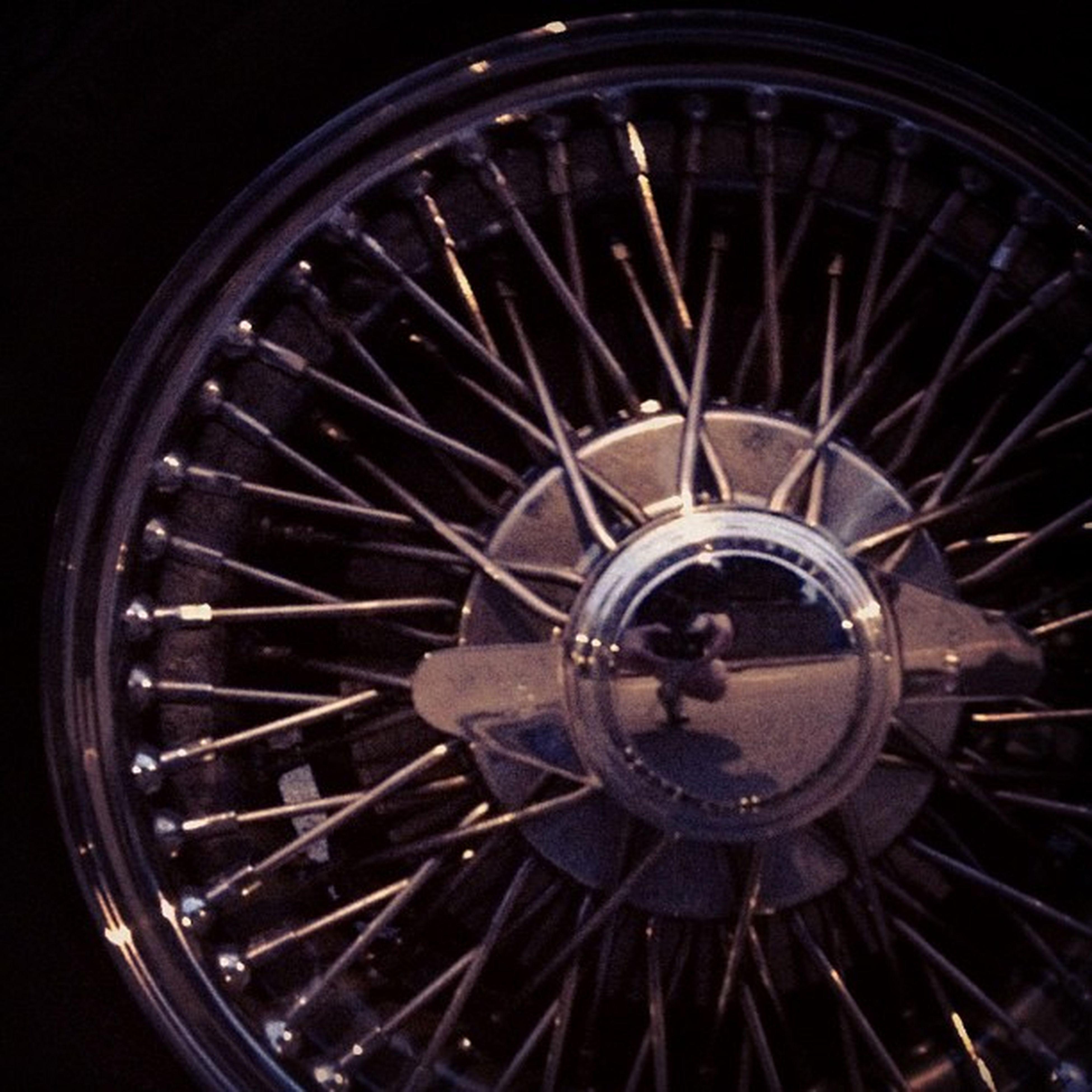 circle, wheel, metal, geometric shape, indoors, time, close-up, round, old-fashioned, clock, metallic, no people, pattern, illuminated, retro styled, ferris wheel, night, low angle view, shape, circular
