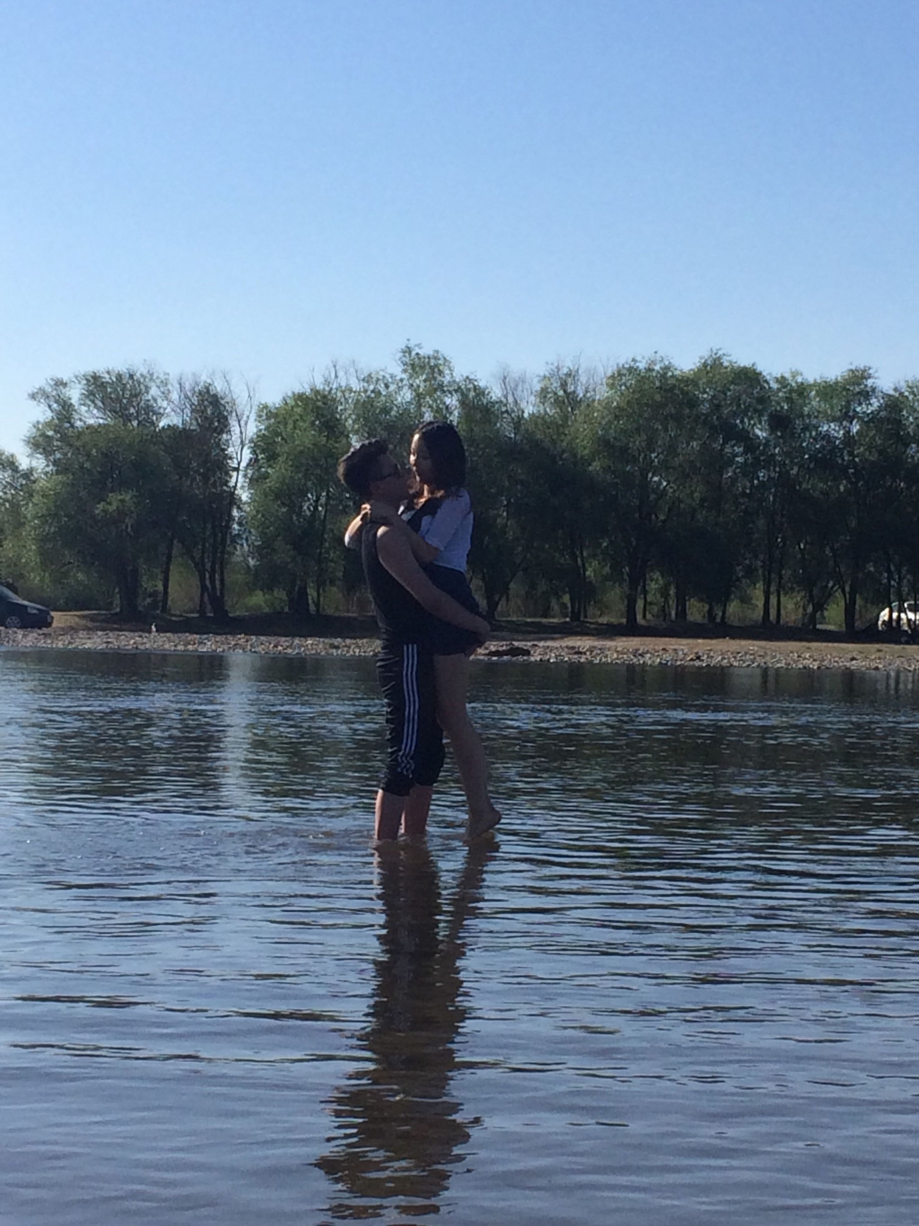 water, lifestyles, leisure activity, tree, full length, clear sky, young adult, waterfront, casual clothing, enjoyment, standing, lake, person, young women, nature, vacations, rear view, day