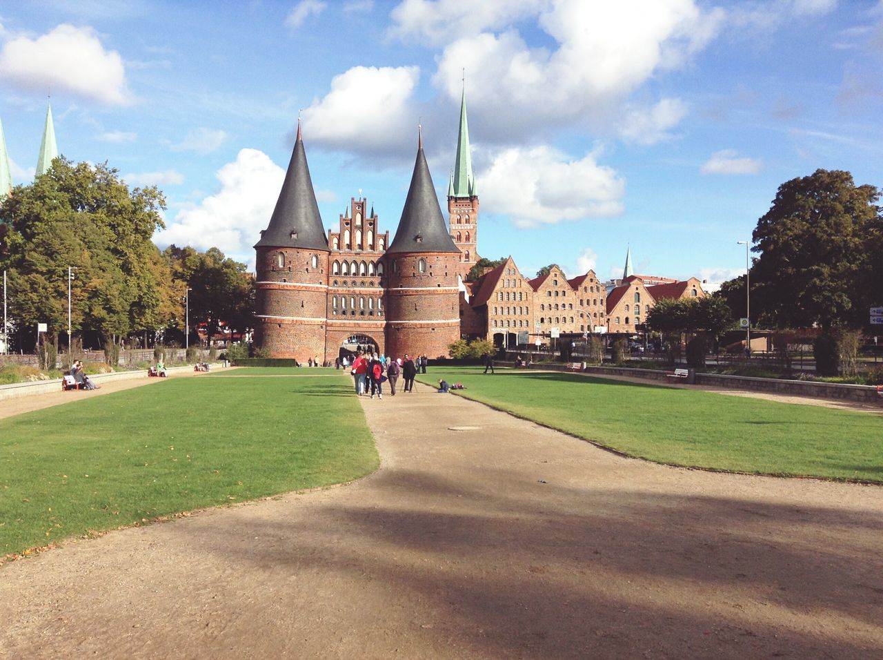 The Holstentor Lübeck From A Distance. · Lübeck Germany Schleswig-Holstein Hansestadt Lübeck Hl Landmarks Monuments Sightseeing Architecture Travel Destinations Travel Tourism Outdoors Beautiful Day Like A Postcard