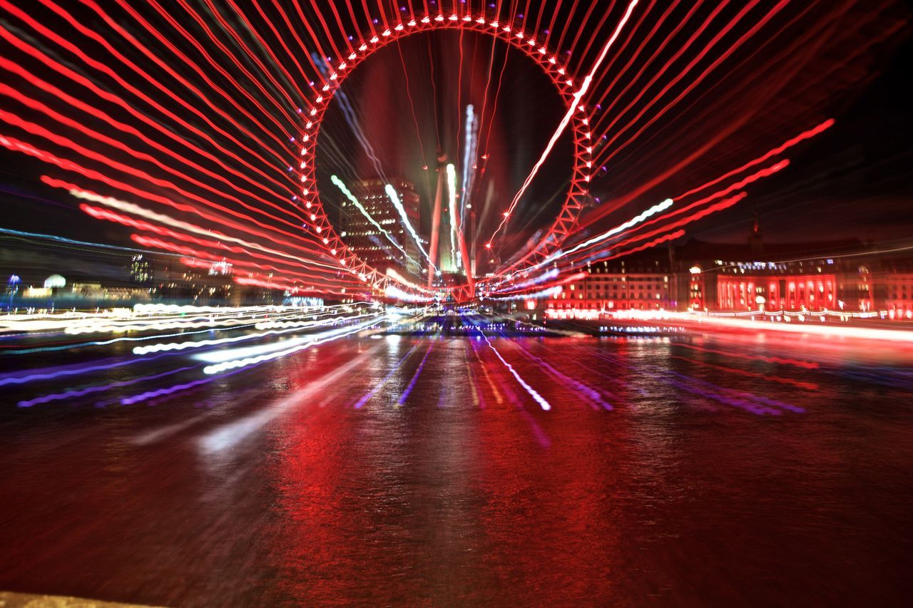 Architecture Blurred Motion Building Exterior Built Structure City Cityscape Ferris Wheel Illuminated London Eye Long Exposure Motion Night No People Outdoors Reflection Speed Water Zoom Burst Zoom In Zoomeffect
