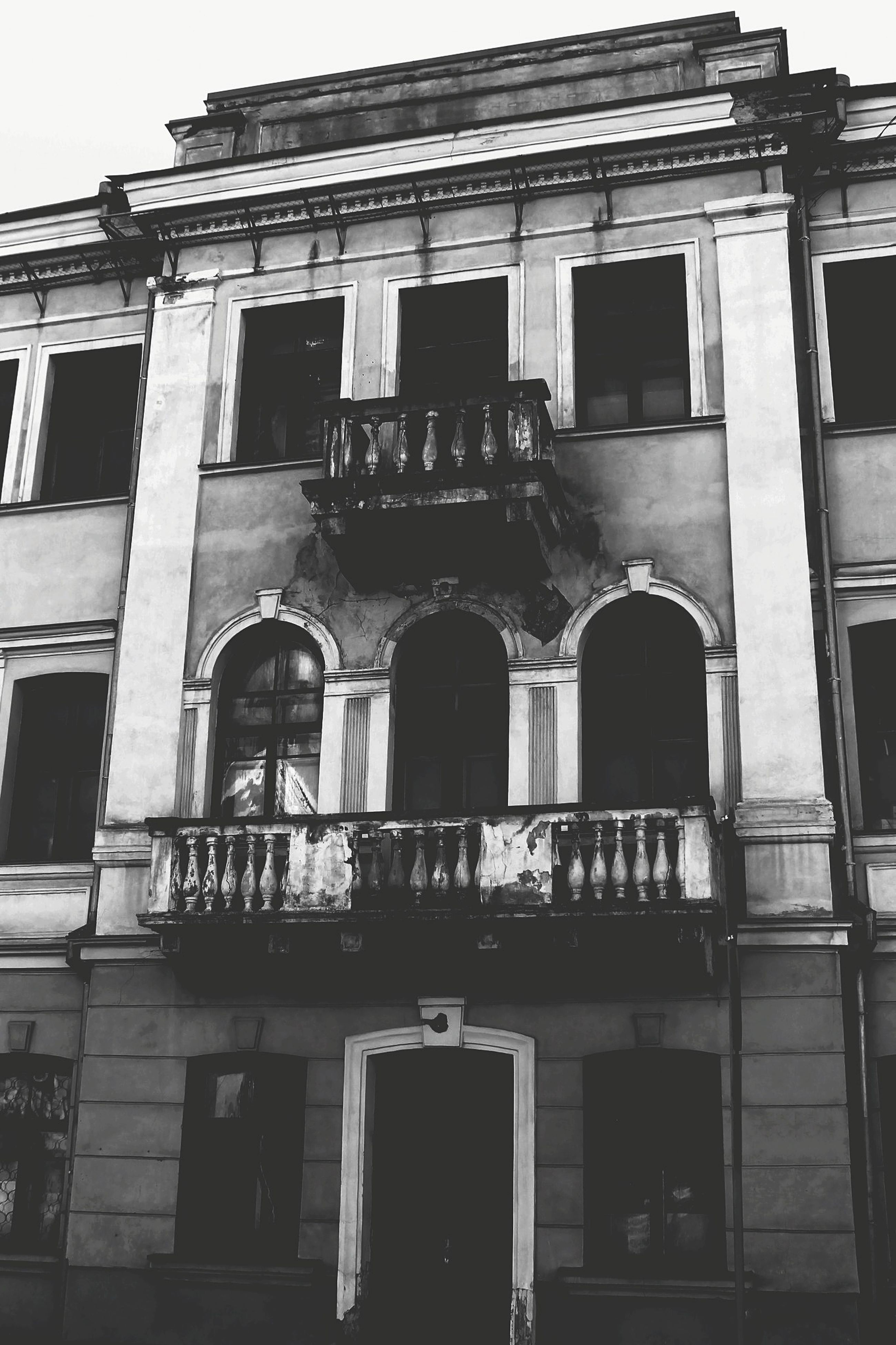 architecture, building exterior, built structure, window, low angle view, building, residential building, old, facade, residential structure, balcony, house, exterior, arch, day, outdoors, no people, city, glass - material, door