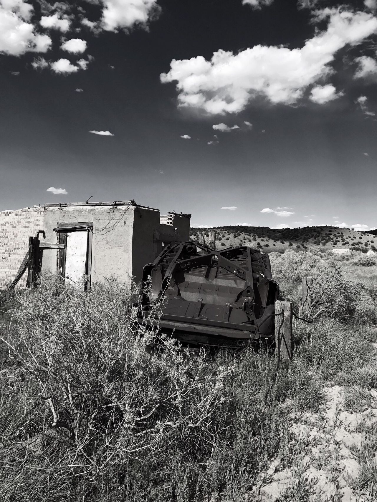 """""""End Of The Road"""" An upside down car, an abandoned building, supervised by nothing more than the New Mexico sky, are just few of the elements remaining in the ghost town of Ancho, New Mexico. Abandoned Sky Outdoors Landscape Old Cars Abandoned Places Abandoned Buildings Abandoned & Derelict Ghost Town Abandoned Car Newmexicophotography New Mexico New Mexico Skies Clouds And Sky"""