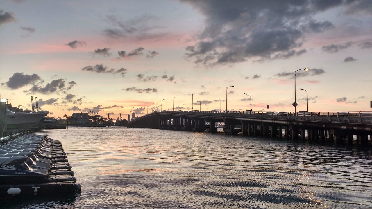 sunset, water, cloud - sky, sky, no people, river, outdoors, transportation, bridge - man made structure, nautical vessel, built structure, nature, moored, architecture, building exterior, beauty in nature, day