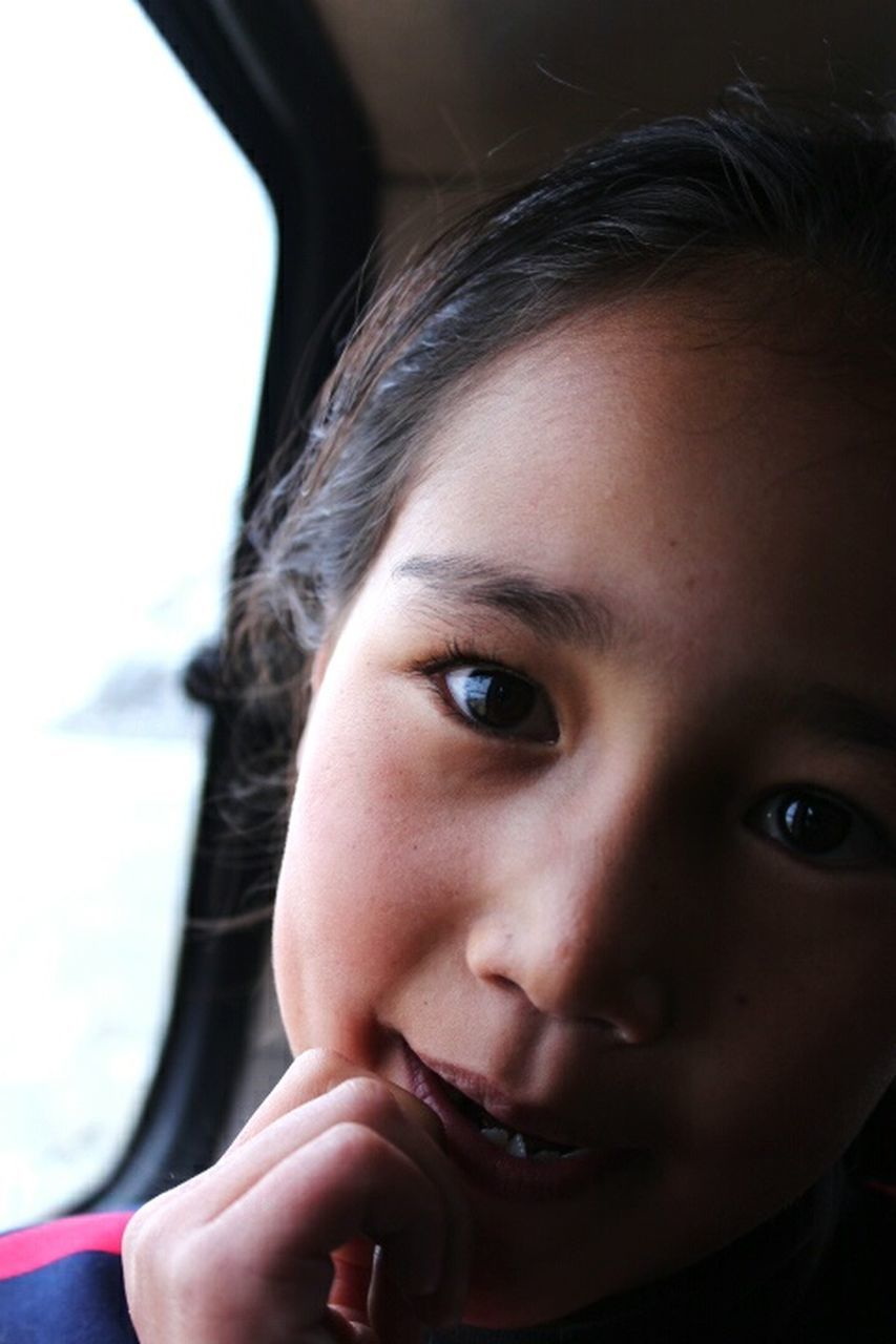 car, transportation, land vehicle, real people, one person, looking at camera, portrait, childhood, close-up, young adult, day, people