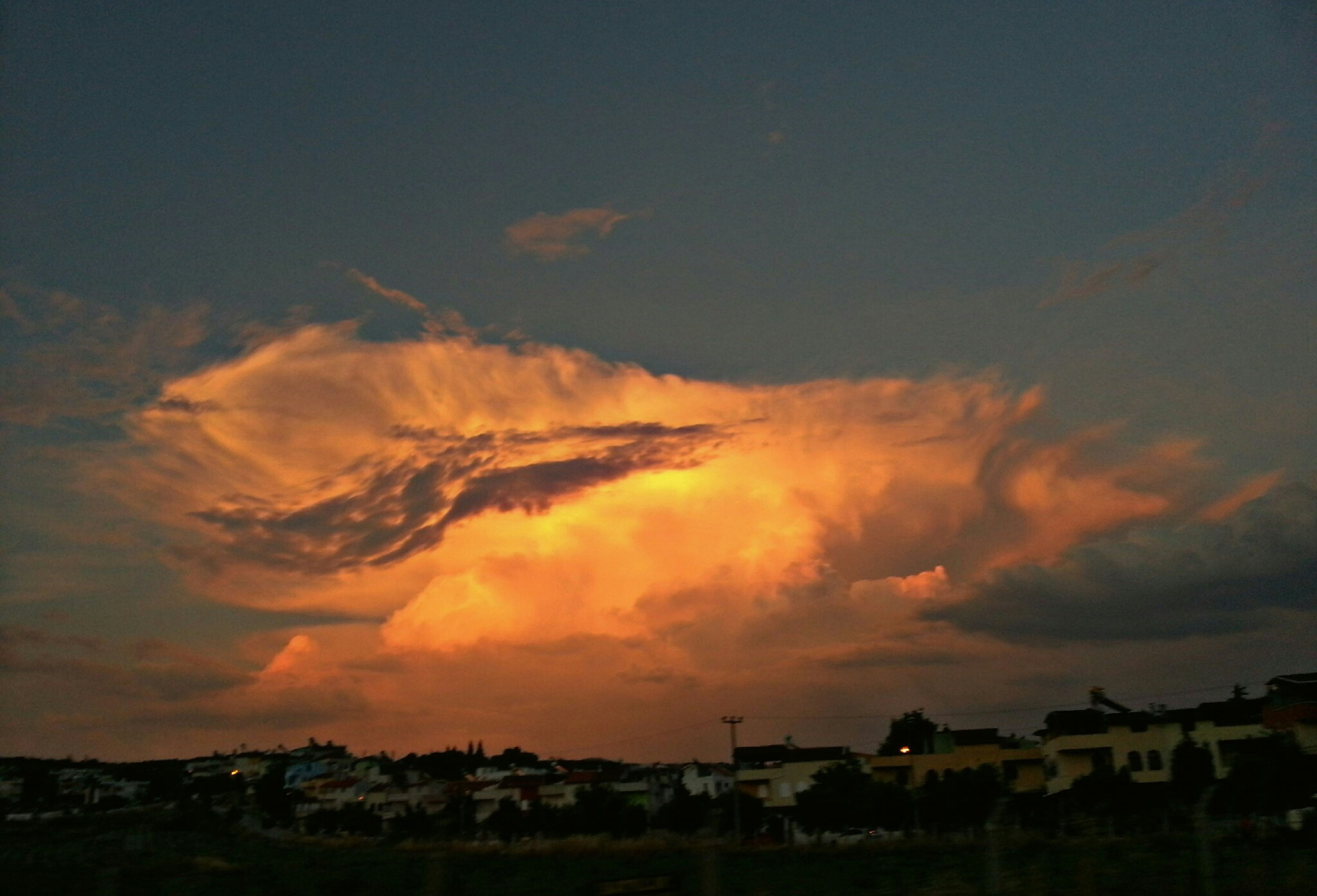 sunset, sky, orange color, cloud - sky, silhouette, scenics, landscape, beauty in nature, building exterior, tranquil scene, built structure, tranquility, dramatic sky, nature, architecture, house, idyllic, cloud, dusk, cloudy