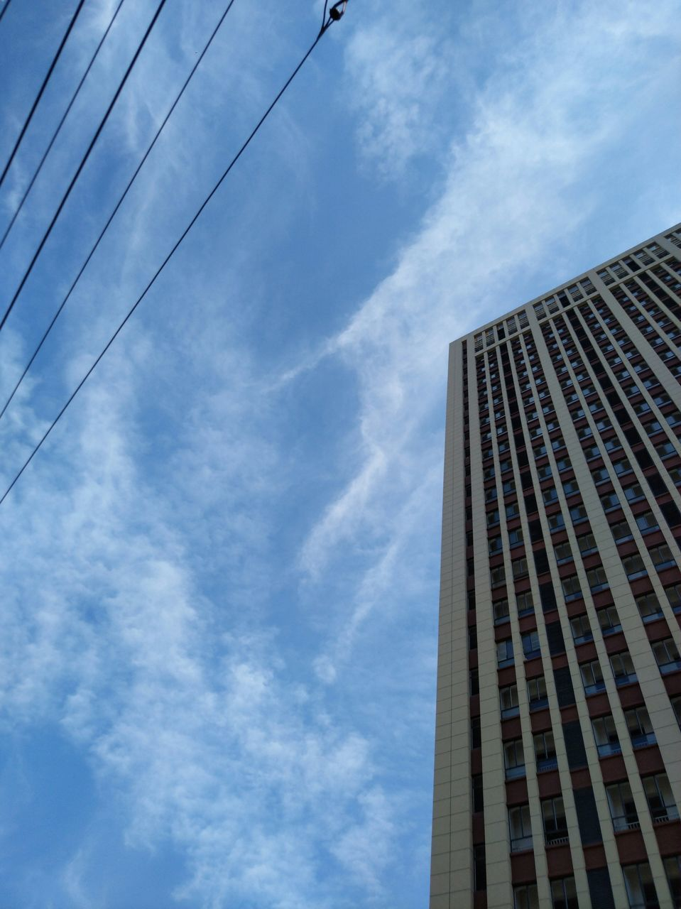 skyscraper, architecture, low angle view, sky, building exterior, built structure, modern, growth, tall, outdoors, day, corporate business, city, no people, blue