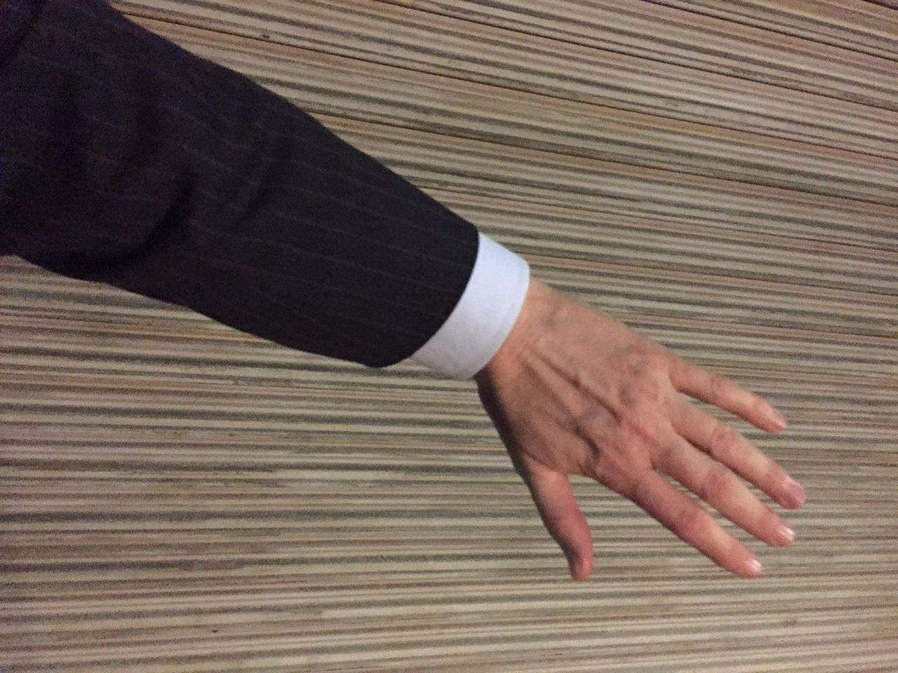 Cropped Hand Against Store