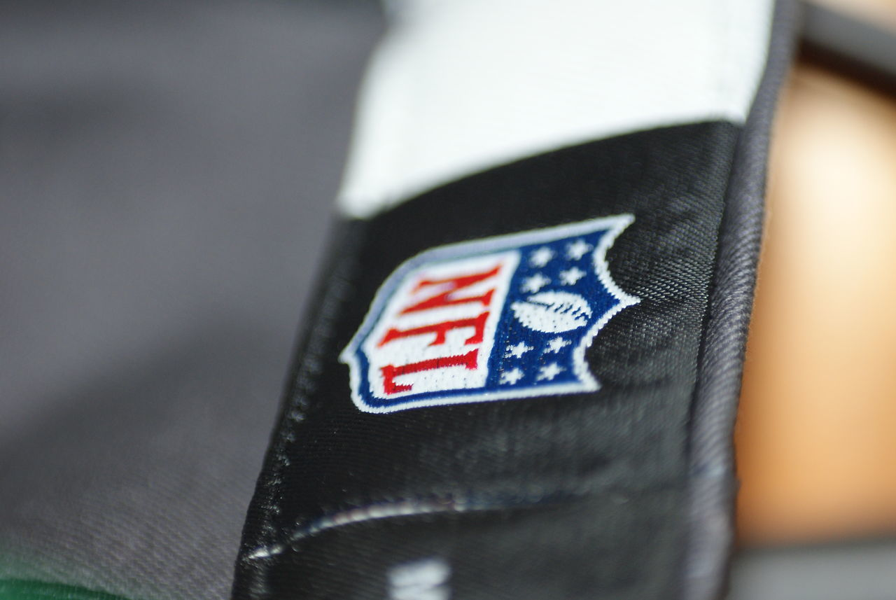 Black Blue Bokeh Close-up Consumerism Logo NFL NFL Football Product Photography Red White