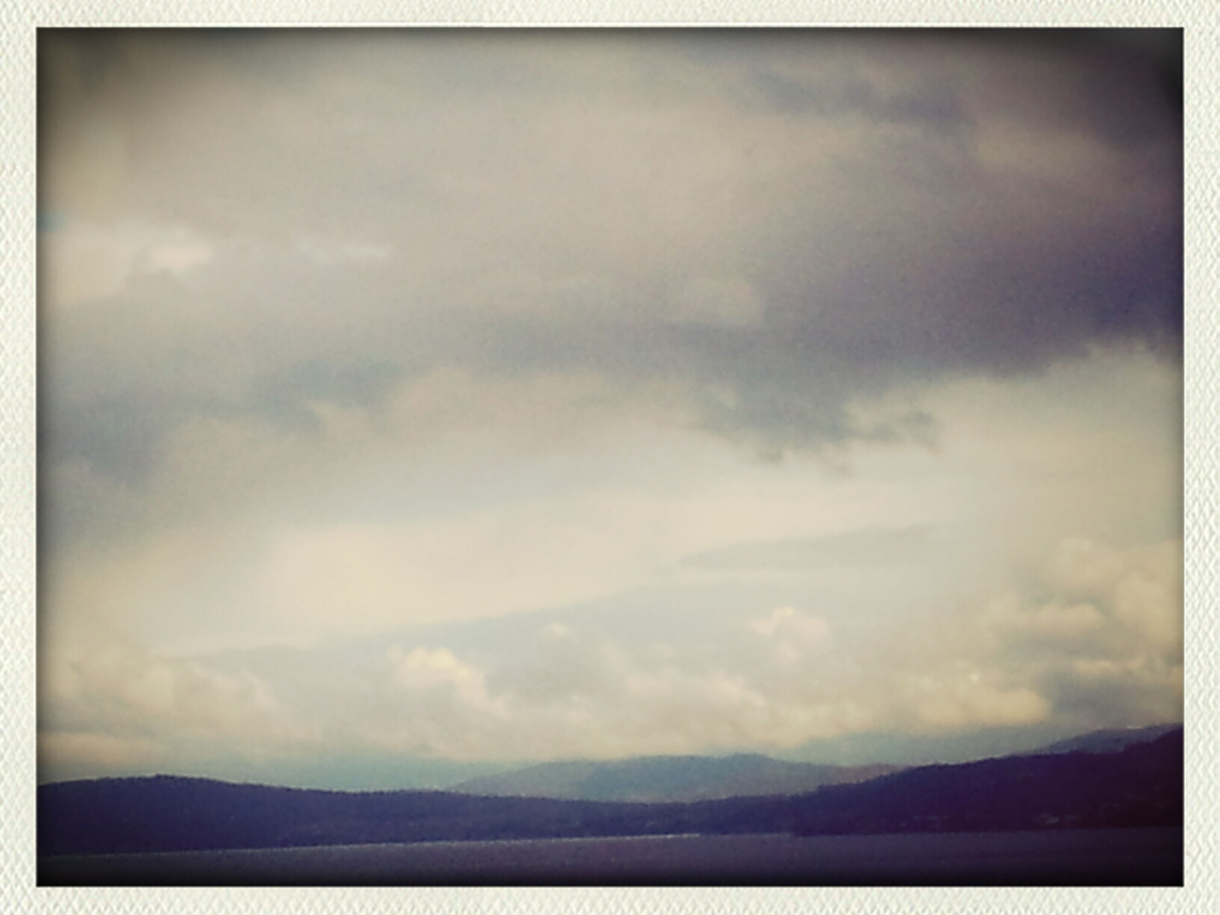 transfer print, sky, mountain, tranquil scene, scenics, tranquility, auto post production filter, beauty in nature, cloud - sky, mountain range, nature, water, cloudy, cloud, idyllic, landscape, lake, outdoors, weather, non-urban scene