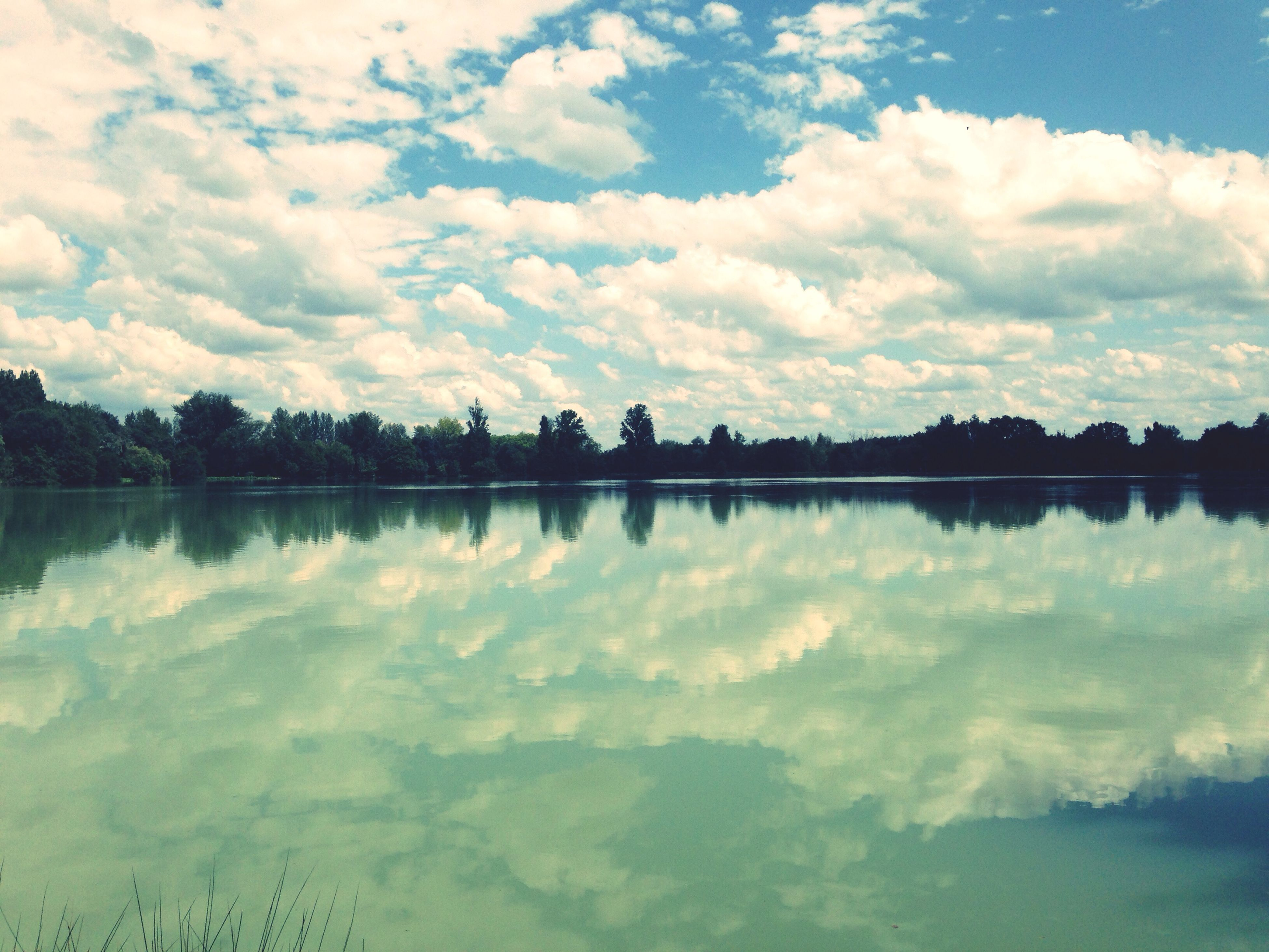 water, reflection, sky, lake, tranquil scene, tranquility, cloud - sky, scenics, beauty in nature, cloud, waterfront, nature, standing water, silhouette, tree, cloudy, calm, idyllic, outdoors, blue