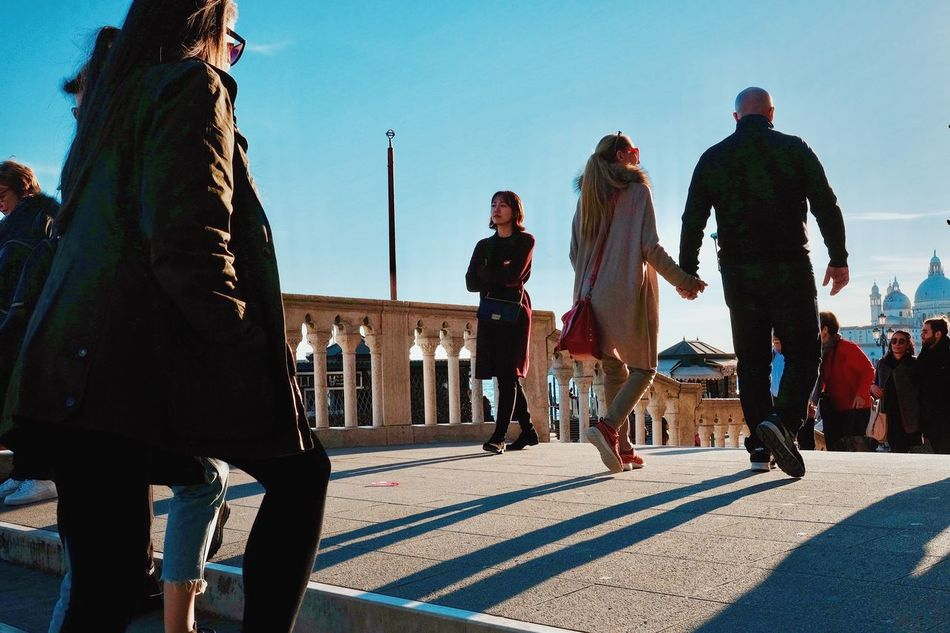 Towards the Piazza. Real People Lifestyles Full Length Women Leisure Activity Sky Sunlight Men Outdoors Young Adult Young Women Day Friendship Adult Adults Only People