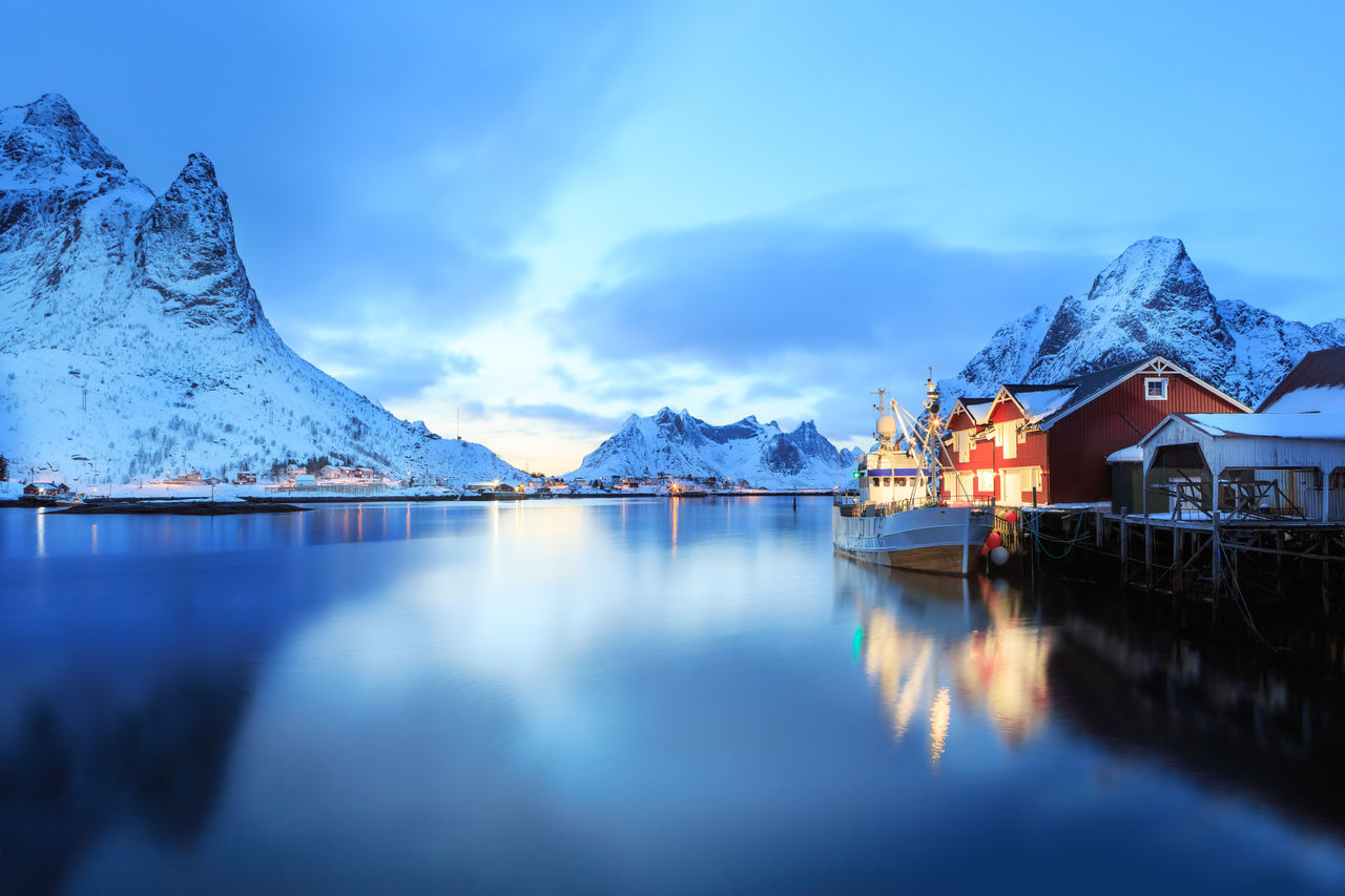 The fisherman village Reine on Lofoten Islands by night, Norway Architecture Barents Sea, Lofoten Islands, Northern, Reine, Town, Arctic, Atlantic, Coast, Cold, Europe, Fishing, Fjord, Harbor, Holiday, Ice, Landscape, Mountains, Nature, Night, Nordic, Nordland, North, North Sea, Norway, Norwegian, Ocean, Outdoor, Outdoors, Polar C Beauty In Nature Blue Cold Temperature Day Iceberg Lake Mountain Mountain Range Nature No People Outdoors Reflection Scenics Sky Snow Snowcapped Mountain Tranquil Scene Tranquility Water Winter