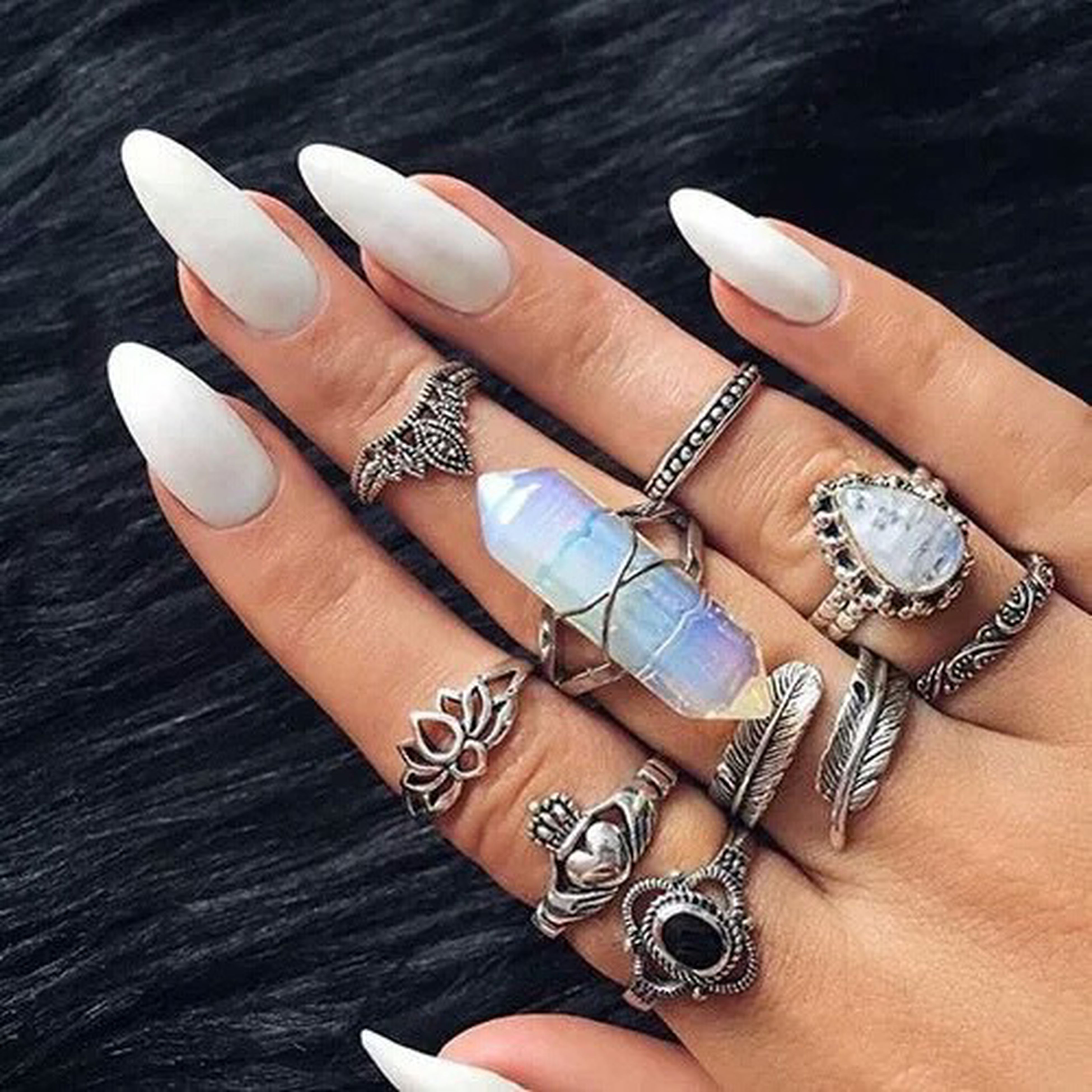 person, part of, indoors, high angle view, personal perspective, human finger, holding, table, cropped, close-up, unrecognizable person, jewelry, nail polish, fashion, leisure activity, lifestyles, ring